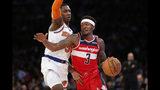 Washington Wizards guard Bradley Beal (3) drives around New York Knicks forward RJ Barrett during the first half of a preseason NBA basketball game in New York, Friday, Oct. 11, 2019. (AP Photo/Kathy Willens)
