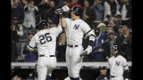 New York Yankees'DJ LeMahieu (26) celebrates with Aaron Judge after hitting a solo home run against the Houston Astros during the first inning of Game 5 of baseball's American League Championship Series, Friday, Oct. 18, 2019, in New York. (AP Photo/Frank Franklin II)