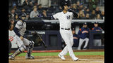 New York Yankees' Aaron Hicks watches his three-run home run against the Houston Astros during the first inning in Game 5 of baseball's American League Championship Series Friday, Oct. 18, 2019, in New York. (AP Photo/Matt Slocum)