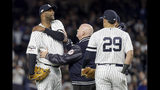 New York Yankees trainer Steve Donohue, center, checks on pitcher CC Sabathia during the eighth inning of Game 4 of baseball's American League Championship Series against the Houston Astros, Thursday, Oct. 17, 2019, in New York. (AP Photo/Frank Franklin II)