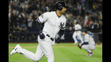 New York Yankees' Aaron Hicks rounds the bases after a three-run home run off Houston Astros starting pitcher Justin Verlander during the first inning in Game 5 of baseball's American League Championship Series Friday, Oct. 18, 2019, in New York. (AP Photo/Matt Slocum)