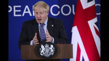 British Prime Minister Boris Johnson answers questions during a media conference at an EU summit in Brussels, Thursday, Oct. 17, 2019. Britain and the European Union reached a new tentative Brexit deal on Thursday, hoping to finally escape the acrimony, divisions and frustration of their three-year divorce battle. (AP Photo/Francisco Seco)