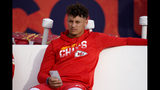 Kansas City Chiefs quarterback Patrick Mahomes sits on the bench prior to an NFL football game against the Denver Broncos, Thursday, Oct. 17, 2019, in Denver. (AP Photo/Jack Dempsey)