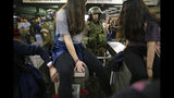 Chile's Carabineros argue with students blocking the turnstile to the subway protesting against the rising cost of subway and bus fare, in Santiago, Friday, Oct. 18, 2019. (AP Photo/Esteban Felix)