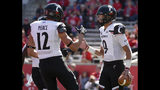 Cincinnati quarterback Desmond Ridder, right, celebrates his touchdown with Alec Pierce during the first half of an NCAA college football game against Houston, Saturday, Oct. 12, 2019, in Houston. (AP Photo/Eric Christian Smith)