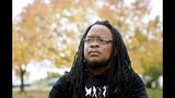 Marlon Anderson poses for a photo Thursday, Oct. 17, 2019 in Madison, Wis. Anderson, a security guard at a Wisconsin high school who was fired after he says he repeated a racial slur while telling a student who had called him that word not to use it, has filed a grievance seeking his job back. (Steve Apps/Wisconsin State Journal via AP)