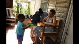 Emma Harrington talks with her great grandchildren on Thursday, Sept. 26, 2019, who on her Walnut Park porch as she keeps watch on the neighborhood. (Christian Gooden/St. Louis Post-Dispatch via AP)/St. Louis Post-Dispatch via AP)