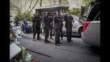 """Pallbearers carry the casket of Chuen Kok from the Ng Fook Funeral Home in Manhattan's Chinese community, Friday Oct. 18, 2019, in New York. Kok, an 83-year-old homeless man whom Chinatown residents warmly greeted as """"uncle,"""" was one of four homeless men bludgeoned to death in the community last week. (AP Photo/Bebeto Matthews)"""