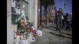 """A makeshift memorial stands at the site for Chuen Kok Friday Oct. 18, 2019, in New York. Kok, an 83-year-old homeless man whom Chinatown residents warmly greeted as """"uncle,"""" was one of four homeless men bludgeoned to death in the community last week. (AP Photo/Bebeto Matthews)"""