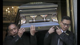 """Pallbearers carry the casket of Chuen Kok from the Ng Fook Funeral Home, Friday Oct. 18, 2019, in New York. Kok, an 83-year-old homeless man whom Chinatown residents warmly greeted as """"uncle,"""" was one of four homeless men bludgeoned to death in the community last week. (AP Photo/Bebeto Matthews)"""