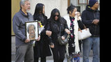 """Mourners gather after a funeral service for Chuen Kok at the Ng Fook Funeral Home Friday Oct. 18, 2019, in New York. Kok, an 83-year-old homeless man whom Chinatown residents warmly greeted as """"uncle,"""" was one of four homeless men bludgeoned to death in the community last week. (AP Photo/Bebeto Matthews)"""