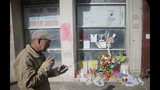 """A makeshift memorial stands for Chuen Kok, Friday Oct. 18, 2019, in New York. Kok, an 83-year-old homeless man whom Chinatown residents warmly greeted as """"uncle,"""" was one of four homeless men bludgeoned to death in the community last week. (AP Photo/Bebeto Matthews)"""