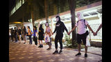 Protesters wear masks in Hong Kong, Friday, Oct. 18, 2019. Hong Kong pro-democracy protesters are donning cartoon/superheroes masks as they formed a human chain across the semiautonomous Chinese city, in defiance of a government ban on face coverings. (AP Photo/Vincent Yu)