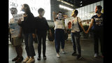 Protesters wear masks during a protest in Hong Kong, Friday, Oct. 18, 2019. Hong Kong pro-democracy protesters are donning cartoon/superhero masks as they formed a human chain across the semiautonomous Chinese city, in defiance of a government ban on face coverings. (AP Photo/Mark Schiefelbein)