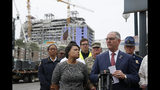 New Orleans Mayor Latoya Cantrell and Louisiana Gov. John Bel Edwards address reporters near the Hard Rock Hotel, Thursday, Oct. 17, 2019, in New Orleans. The 18-story hotel project that was under construction collapsed last Saturday, killing three workers. Two bodies remain in the wreckage. (AP Photo/Gerald Herbert)