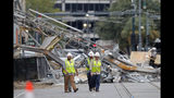 """Workers walk from the site of the Hard Rock Hotel in New Orleans, Wednesday, Oct. 16, 2019. New Orleans officials say the chances of a missing worker's survival after the collapse are diminishing, and they have shifted their efforts from rescue to recovery mode. News outlets report Fire Department Superintendent Tim McConnell says they shifted Wednesday ahead of a possible tropical storm. McConnell says chances of the missing worker's survival will be considered nearly """"zero"""" if no sign of him turns up by Wednesday night. (AP Photo/Gerald Herbert)"""
