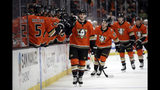 Anaheim Ducks' Troy Terry, center, is high-fived after scoring against the Carolina Hurricanes during the first period of an NHL hockey game Friday, Oct. 18, 2019, in Anaheim, Calif. (AP Photo/Marcio Jose Sanchez)