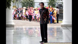 In this Oct. 7, 2019, photo, Indonesian President Joko Widodo pauses during an event at the presidential palace in Bogor, Indonesia. Known for his down-to-earth style with a reputation for clean governance, Widodo's signature policy has been improving Indonesia's inadequate infrastructure and reducing poverty, which afflicts close to a tenth of Indonesia's nearly 270 million people. But raising money would be harder at a time of global economic slowdown, major trade conflicts and falling exports. (AP Photo/Dita Alangkara)