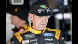 Clint Bowyer walks from the garage area following practice for a NASCAR Cup Series auto race at Kansas Speedway in Kansas City, Kan., Friday, Oct. 18, 2019. (AP Photo/Colin E. Braley)