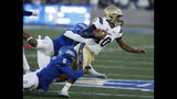 Tulsa's Cristian Williams and Brandon Johnson (8) bring down Navy quarterback Malcolm Perry (10) during an NCAA college football game, Saturday, Oct. 12, 2019, in Tulsa, Okla. (Stephen Pingry/Tulsa World via AP)