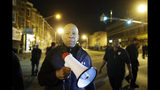 FILE - In this April 29, 2015, file photo, U.S. Rep. Elijah Cummings, D-Md., encourages protesters to comply with the 10 p.m. curfew in Baltimore, after unrest over the death of Freddie Gray while in police custody. Cummings, a sharecropper's son who rose to become the powerful chairman of one of the U.S. House committees leading an impeachment inquiry of President Donald Trump, died Thursday, Oct. 17, 2019, of complications from longstanding health issues. He was 68. (AP Photo/Matt Rourke, File)