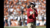 Oklahoma head coach Lincoln Riley applauds his team during the second half of an NCAA college football game against Texas at the Cotton Bowl, Saturday, Oct. 12, 2019, in Dallas. Oklahoma won 34-27. (AP Photo/Jeffrey McWhorter)
