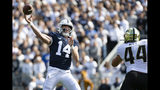 Penn State quarterback Sean Clifford (14) passes over Purdue linebacker Ben Holt (44) in the second quarter of an NCAA college football game in State College, Pa., on Saturday, Oct. 5, 2019. (AP Photo/Barry Reeger)