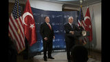 FILE - In this Thursday, Oct. 17, 2019 file photo, U.S Vice President Mike Pence, right, speaks at the U.S. ambassador's residence during a news conference with Secretary of State Mike Pompeo after their meeting with Turkish President Recep Tayyip Erdogan, in Ankara, Turkey, The Turkish assault on northern Syria in the wake of President Donald Trump's troop withdrawal from the region has jeopardized a goal often spotlighted by Trump: global freedom to worship for religious minorities. Top Trump advisers said a Thursday ceasefire would help minority faiths, but it's not yet clear that the pact will give them the durable protection Kurdish control had offered. (AP Photo/Burhan Ozbilici, File)