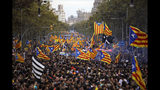 Protestors wave Estelada pro-independence flags during a demonstration in Barcelona, Spain, Friday, Oct. 18, 2019.The Catalan regional capital is bracing for a fifth day of protests over the conviction of a dozen Catalan independence leaders. Five marches of tens of thousands from inland towns are converging in Barcelona's center for a mass protest. (AP Photo/Emilio Morenatti)