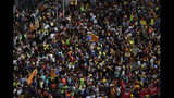 "Protesters pack the street on the fifth day of protests over the conviction of a dozen Catalan independence leaders in Barcelona, Spain, Friday, Oct. 18, 2019. Tens of thousands of flag-waving demonstrators demanding Catalonia's independence and the release from prison of their separatist leaders have flooded downtown Barcelona. The protesters have poured into the city after some of them walked for three days in ""Freedom marches"" from towns across the northeastern Spanish region, joining students and workers who have also taken to the streets on a general strike day. (AP Photo/Manu Fernandez)"