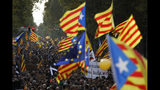 A European Union flag, in the center, is waved together with Estelada pro-independence flags during a demonstration in Barcelona, Spain, Friday, Oct. 18, 2019.The Catalan regional capital is bracing for a fifth day of protests over the conviction of a dozen Catalan independence leaders. Five marches of tens of thousands from inland towns are converging in Barcelona's center for a mass protest. (AP Photo/Emilio Morenatti)