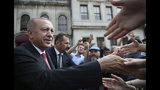 """Turkish President Recep Tayyip Erdogan shakes hands with his supporters after Friday prayers, in Istanbul, Friday, Oct. 18, 2019. Erdogan says his country """"cannot forget"""" an unusual letter that U.S. President Donald Trump sent him, but says the mutual """"love and respect"""" between the leaders prevent him from keeping it on Turkey's agenda.(Presidential Press Service via AP, Pool )"""