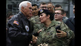 Vice President Mike Pence greets U.S. troops after speaking at Ramstein Air Force Base, Germany, Friday, Oct. 18, 2019. (AP Photo/Jacquelyn Martin)