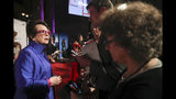 In this Wednesday, Oct. 16, 2019, photo tennis great and founder of Women's Sports Foundation Billie Jean King, left, talks to reporters on the red carpet of the Women's Sports Foundation's 40th annual Salute to Women in Sports in New York. (AP Photo/Mary Altaffer)