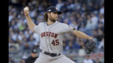 Houston Astros starting pitcher Gerrit Cole (45) delivers against the New York Yankees during the first inning of Game 3 of baseball's American League Championship Series, Tuesday, Oct. 15, 2019, in New York. (AP Photo/Frank Franklin II)