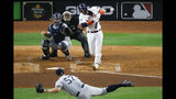 Houston Astros' Yuli Gurriel hits a three-run home run off New York Yankees pitcher Chad Green during the first inning in Game 6 of baseball's American League Championship Series Saturday, Oct. 19, 2019, in Houston. (AP Photo/Sue Ogrocki)