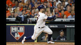 Houston Astros' Jose Altuve hits a double against the New York Yankees during the first inning in Game 6 of baseball's American League Championship Series Saturday, Oct. 19, 2019, in Houston.(AP Photo/Matt Slocum)