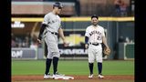New York Yankees' Aaron Judge, left, talks with Houston Astros second baseman Jose Altuve during the third inning in Game 6 of baseball's American League Championship Series Saturday, Oct. 19, 2019, in Houston. (AP Photo/Eric Gay)