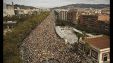Protesters march into the city on the fifth day of protests over the conviction of a dozen Catalan independence leaders in Barcelona, Spain, Friday, Oct. 18, 2019. Various flights into and out of the region are cancelled Friday due to a general strike called by pro-independence unions and five marches of tens of thousands from inland towns are expected converge in Barcelona's center on Friday afternoon for a mass protest with students to and workers who are on strike. (AP Photo/Joan Mateu)