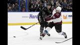 Colorado Avalanche center Nazem Kadri (91) scores a third period goal as Tampa Bay Lightning defenseman Kevin Shattenkirk (22) defends an NHL hockey game Saturday, Oct. 19, 2019, in Tampa, Fla. (AP Photo/Jason Behnken)