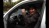 Bolivia's President Evo Morales pumps his fist at members of the press after a visit to a trout farm where he stopped to eat, in Incachaca, Bolivia, Saturday, Oct. 19, 2019. Morales is seeking a fourth term in Sunday's general elections. (AP Photo/Juan Karita)