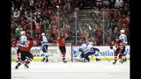 New Jersey Devils' Jack Hughes, right, celebrates with teammates after scoring a goal during the first period of an NHL hockey game against the Vancouver Canucks, Saturday, Oct. 19, 2019, in Newark, N.J. (AP Photo/Frank Franklin II)
