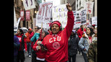 Thousands of striking Chicago Teachers Union members and their supporters march through the Loop, Thursday, Oct. 17, 2019, in Chicago. (Ashlee Rezin Garcia/Chicago Sun-Times via AP)