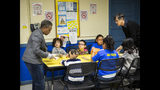 Mayor Lori Lightfoot and first lady Amy Eshleman pass out breakfast to Chicago Public Schools students at a contingency site, Gads Hill Center Friday, Oct. 18, 2019. Striking Chicago teachers have returned to the picket lines for a second day as union and city bargainers try to hammer out a contract in the nation's third-largest school district. (Ashlee Rezin Garcia /Chicago Sun-Times via AP)