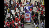 Thousands of teachers, teacher's union members, and supporters gathered near the Chicago Public School headquarters and march on the streets in downtown Chicago, Thursday, Oct. 17, 2019. The strike in the nation's third-largest school district came after the Chicago Teachers Union confirmed Wednesday night that its 25,000 members would not return to their classrooms. (Victor Hilitski/Chicago Sun-Times via AP)