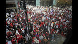 Thousands of teachers, teacher's union members, and supporters gathered near the Chicago Public School headquarters and march on the streets in downtown Chicago on Thursday, Oct. 17, 2019. (Victor Hilitski/Chicago Sun-Times via AP)