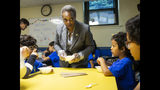 Mayor Lori Lightfoot passes out breakfast to Chicago Public Schools students at a contingency site, Gads Hill Center, Friday, Oct. 18, 2019. Striking Chicago teachers have returned to the picket lines for a second day as union and city bargainers try to hammer out a contract in the nation's third-largest school district. (Ashlee Rezin Garcia /Chicago Sun-Times via AP)