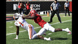 Clemson cornerback Derion Kendrick (1) and Louisville defensive back Russ Yeast (3) battle for a loose ball following a Louisville punt during the first half of an NCAA college football game in Louisville, Ky., Saturday, Oct. 19, 2019. (AP Photo/Timothy D. Easley)