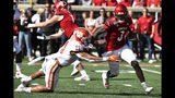 Clemson linebacker Isaiah Simmons (11) attempts to bring down Louisville quarterback Micale Cunningham (3) during the first half of an NCAA college football game in Louisville, Ky., Saturday, Oct. 19, 2019. (AP Photo/Timothy D. Easley)