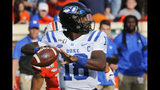 Duke quarterback Quentin Harris (18) looks for a receiver during the first half of an NCAA college football game against Virginia in Charlottesville, Va., Saturday, Oct. 19, 2019. (AP Photo/Steve Helber)